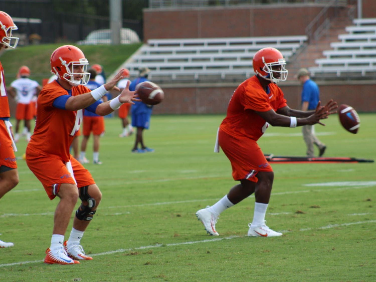 Coach Jim McElwain has yet to make clear which of his top three QBs — Luke Del Rio (left), Malik Zaire (right) and Feleipe Franks — will start.