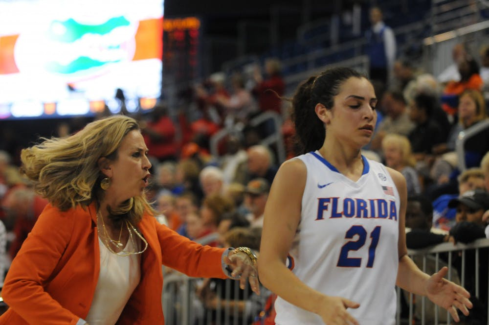 <p>UF women's basketball coach Amanda Butler calls out to guard Eleanna Christinaki at the end of the first half of Florida's 71-61 loss to Georgia on Jan. 14, 2016, in the O'Connell Center.</p>