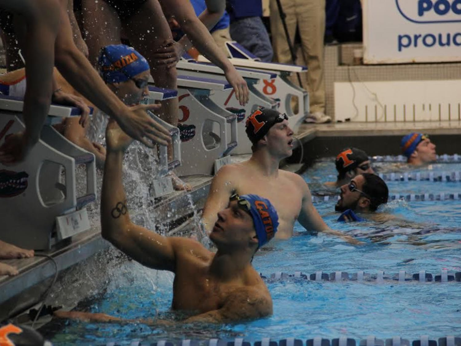 UF swimmer Caeleb Dressel slaps hands with a teammate during Florida's 183-117 win against Tennessee on Jan. 28, 2017, in the O'Connell Center.