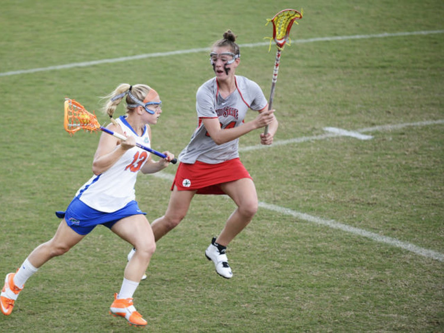 Florida's Ashley Bruns (13) attacks the net against Ohio State defender Tayler Kuzma (24) in the Gators' 13-7 win against the Buckeyes on March 23 at Dizney Stadium. Northwestern held Bruns to one goal in Florida's 8-3 loss on Sunday.