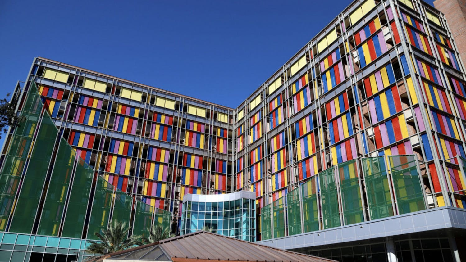 The multi-colored glass of the UF Health Shands Children's Hospital shines as the sun reflects off the panes on September 25, 2020. The pediatric staff provide care in more than 20 specialities including pediatric hematology-oncology.