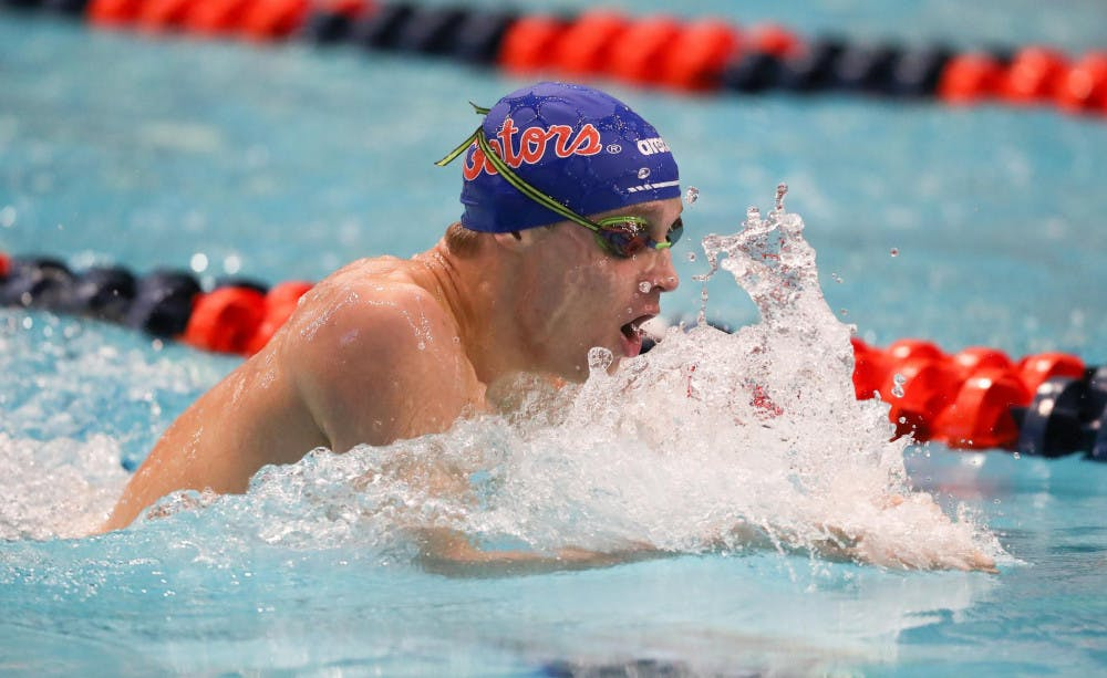 <p>Robert Finke during the Gators' meet on Day 3 of the SEC Championships on Thursday, February 20, 2020 at Martin Aquatics Center in Auburn, Alabama. Finke and other Gators return to Auburn for an invitational this week.</p>