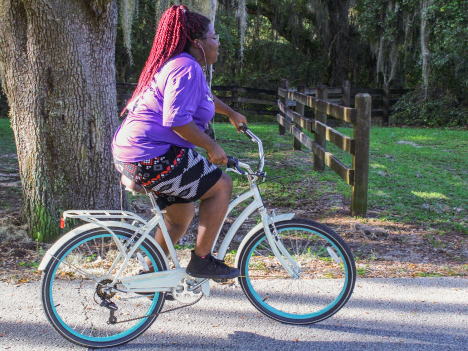 """Tamaria Henderson rides her bicycle to support Metamorphosis of Alachua County, the treatment center where she currently lives and battles her alcohol addiction. """"You have to want it,"""" the 20-year-old said."""
