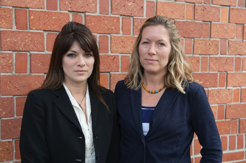 <p>Danielle Ruiz, left, stands with Laura Kalt, her victim advocate at the Gainesville Police Department. Victims can receive free, confidential counseling by contacting the Alachua County Rape Crisis center at 352-264-6760.</p>