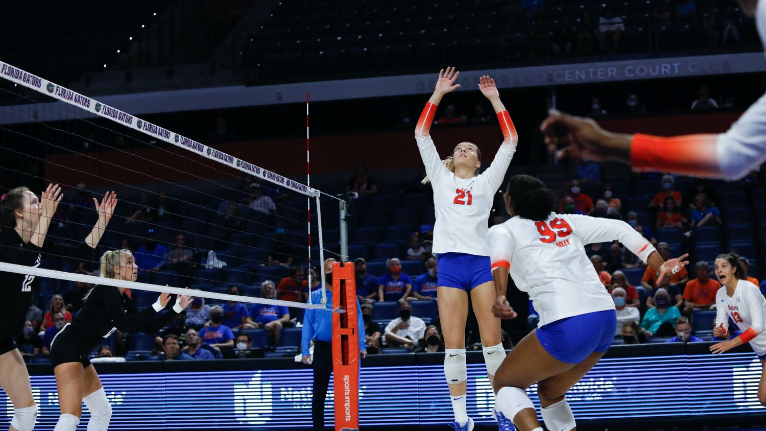 Florida's Marlie Monserez jumps to set the ball against Texas A&M on Oct. 16.