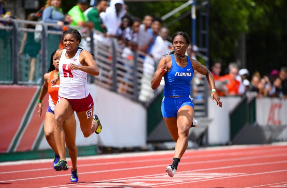 <p>Shayla Sanders runs the 100-meter dash at the Hurricane College Invitational on March 25, 2017.</p>