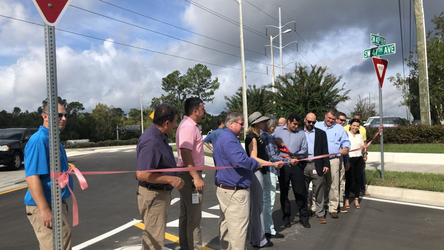 City Commissioner David Arreola cuts the ribbon for the grand opening of the new road linking SW 47th Avenue and 40th Boulevard to Archer Road Tuesday at 10:30 a.m.. This road was built to give drivers a more direct route through the city as well as pull traffic off Archer Road, 34th Street and I-75.