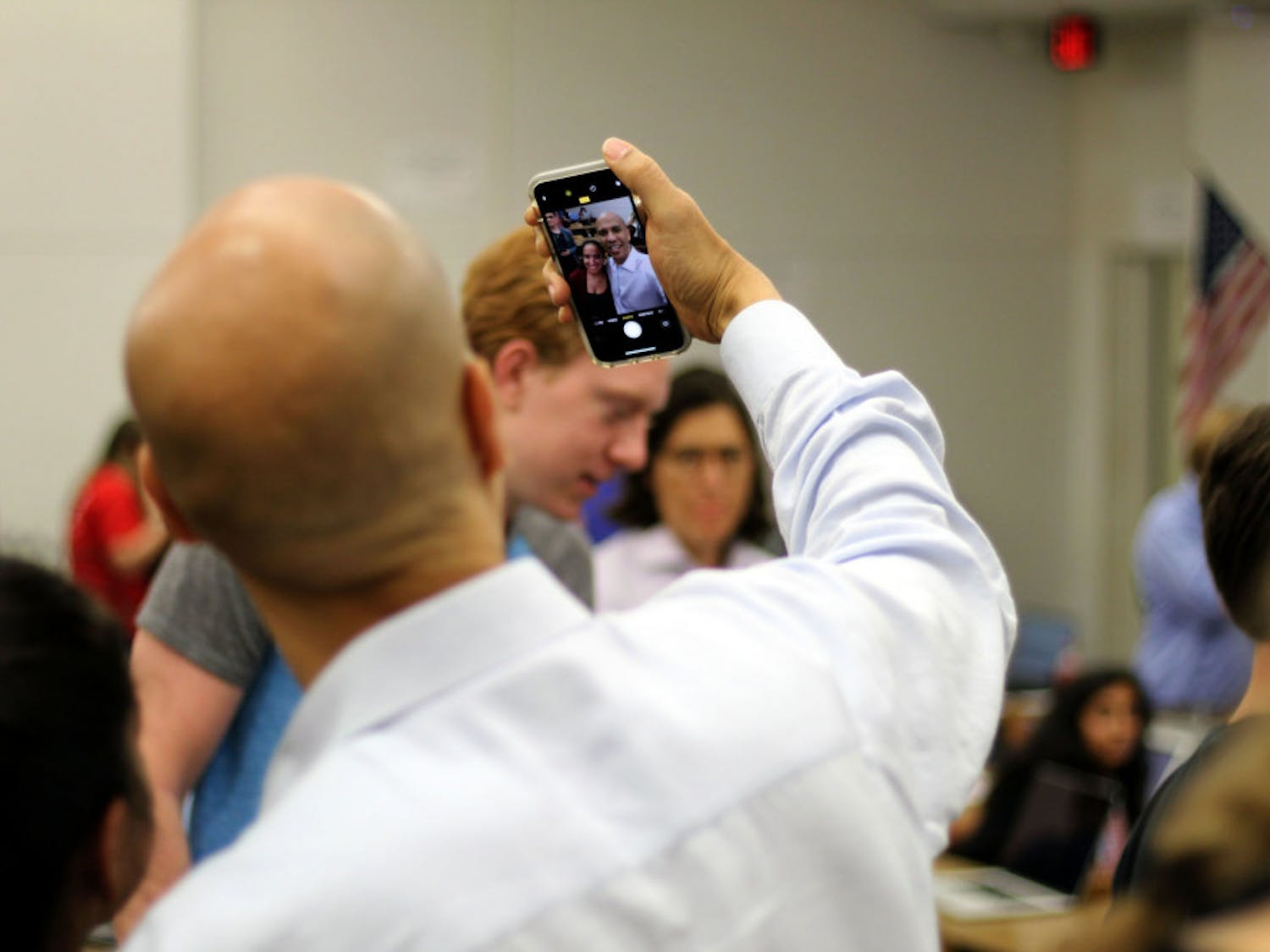 """New Jersey Senator Cory Booker and Senator Bill Nelson meet with UF College Democrats at Weil Hall on Friday afternoon. Senator Booker took selfies and posted an Instagram story of the meeting with students yelling """"Go Gators."""""""