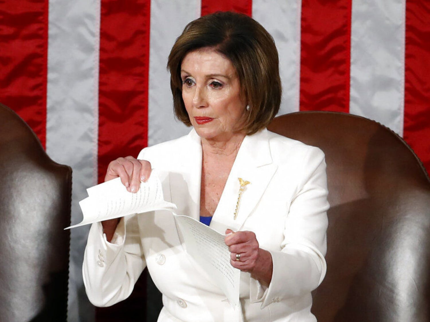 House Speaker Nancy Pelosi of Calif., tears her copy of President Donald Trump's State of the Union address after he delivered it to a joint session of Congress on Capitol Hill in Washington, Tuesday, Feb. 4, 2020. (AP Photo/Alex Brandon)