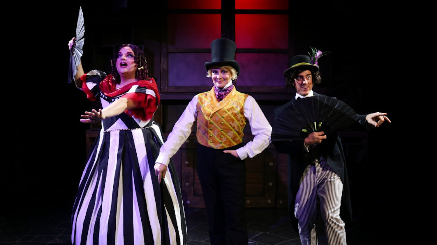 """Actors Matthew McGee, Kelly Atkins and David Patrick Ford take center stage in costume for their roles in the Hippodrome's """"Scrooge in Rouge."""""""