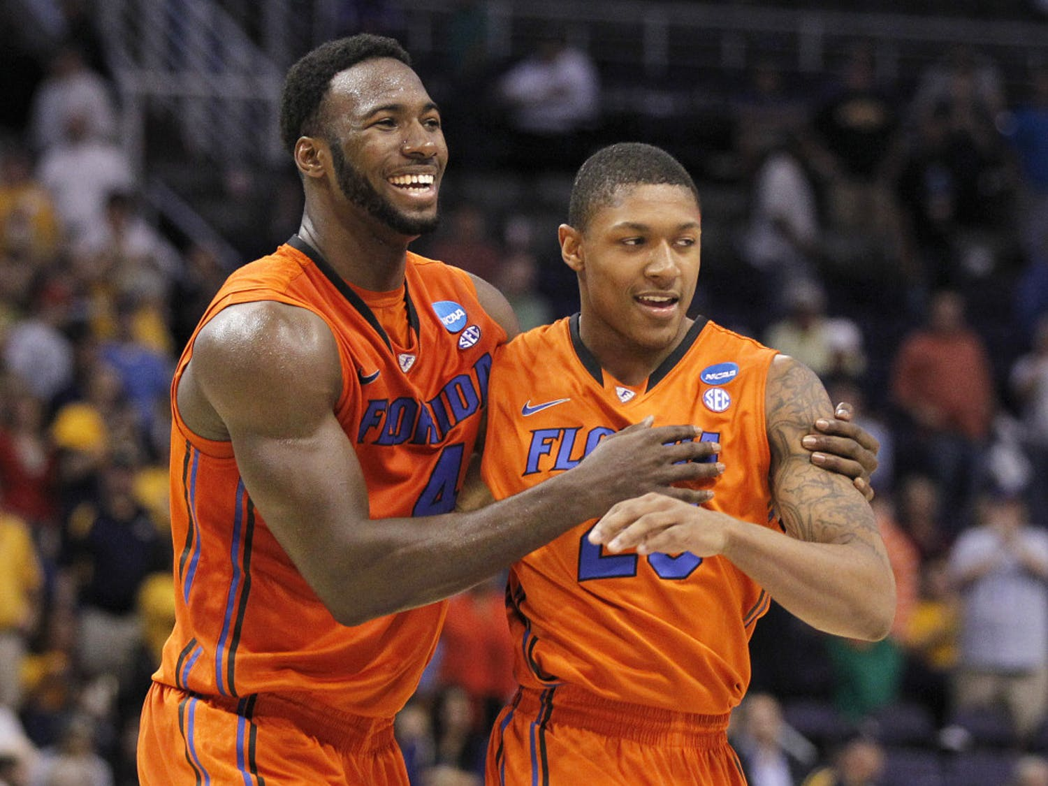 Florida center Patric Young embraces guard Brad Beal during the team's Sweet 16 meeting with Marquette in 2012.