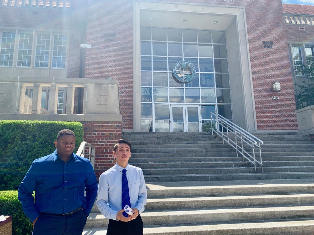 <p>Anthony Rojas, a 23-year-old UF political science master's student, and Mackintosh Joachim, president of the UF chapter of the NAACP, announced a boycott of the university-wide commencement ceremony on Friday afternoon outside Tigert Hall.</p>