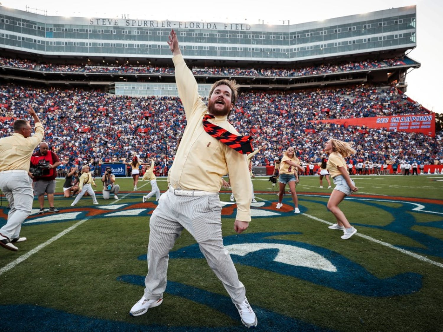 """George Edmondons's family led UF fans in his famous """"two-bits"""" cheer at Saturday night's game. The UF Athletic Association organized the cheer as well as a mural and t-shirt sale honoring the late """"Mr.Two Bits."""""""