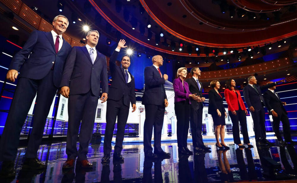 <p>From left, New York City Mayor Bill de Blasio, Rep. Tim Ryan, D-Ohio, former Housing and Urban Development Secretary Julian Castro, Sen. Cory Booker, D-N.J., Sen. Elizabeth Warren, D-Mass., former Texas Rep. Beto O'Rourke, Sen. Amy Klobuchar, D-Minn., Rep. Tulsi Gabbard, D-Hawaii, Washington Gov. Jay Inslee, and former Maryland Rep. John Delaney pose for a photo on stage before the start of a Democratic primary debate hosted by NBC News at the Adrienne Arsht Center for the Performing Arts, Wednesday, June 26, 2019, in Miami.</p>