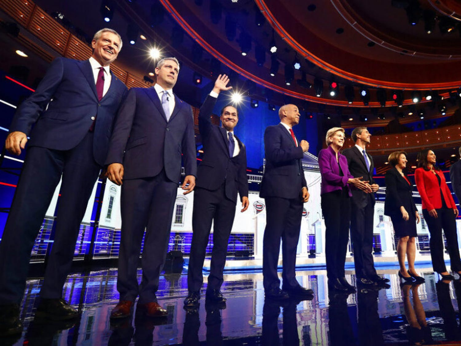 From left, New York City Mayor Bill de Blasio, Rep. Tim Ryan, D-Ohio, former Housing and Urban Development Secretary Julian Castro, Sen. Cory Booker, D-N.J., Sen. Elizabeth Warren, D-Mass., former Texas Rep. Beto O'Rourke, Sen. Amy Klobuchar, D-Minn., Rep. Tulsi Gabbard, D-Hawaii, Washington Gov. Jay Inslee, and former Maryland Rep. John Delaney pose for a photo on stage before the start of a Democratic primary debate hosted by NBC News at the Adrienne Arsht Center for the Performing Arts, Wednesday, June 26, 2019, in Miami.