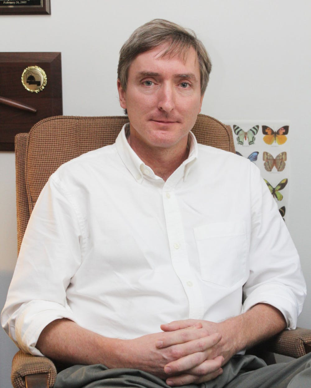 <p>County Commissioner Mike Byerly sits in his office at an Alachua County Commission meeting Tuesday. Byerly is a 12-year commission incumbent.</p>