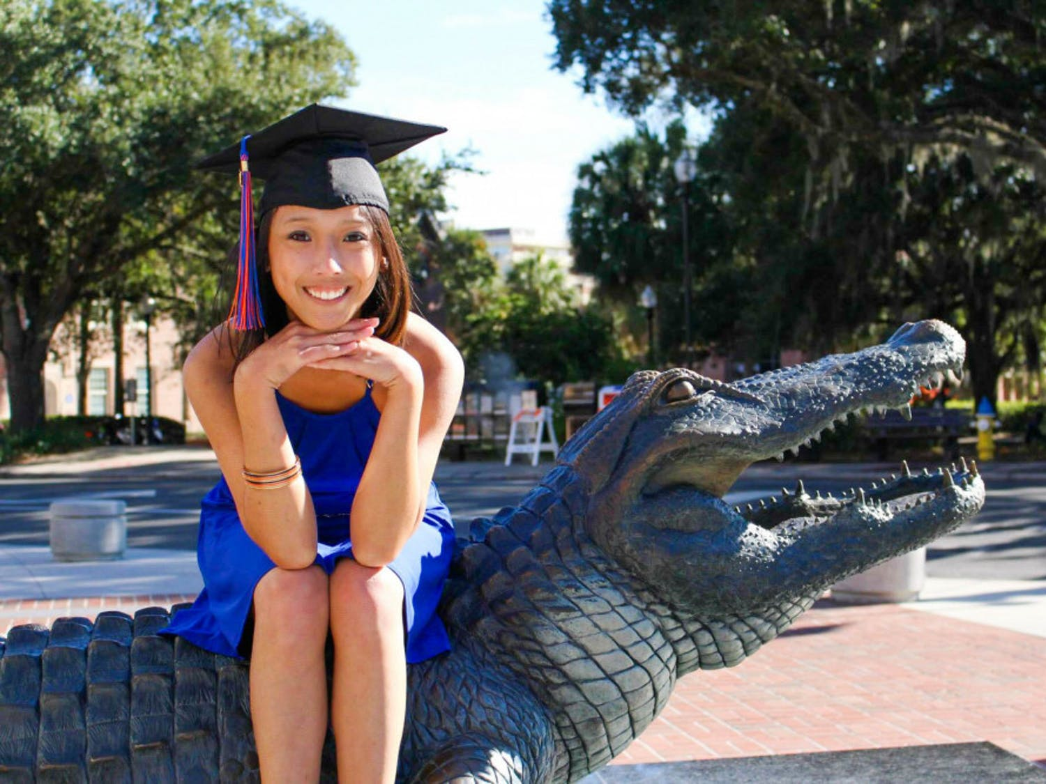 Roselle Derequito poses by the Bull Gator for her graduation photoshoot. Roselle graduated in 2014 with a bachelor's degree in Health Education.
