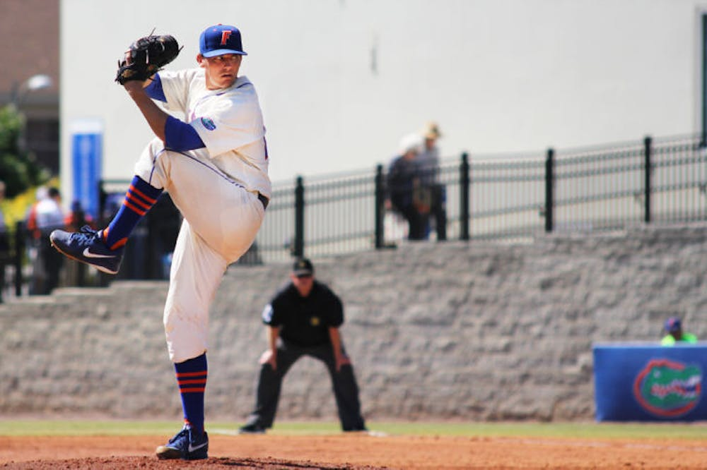 """<p class=""""p1""""><span class=""""s1"""">Junior Jonathon Crawford pitches during Florida's 11-5 loss to Kentucky on March 16 at McKethan Stadium. Crawford&nbsp;allowed just one run in 6.2 innings Thursday against the Bulldogs.</span></p>"""