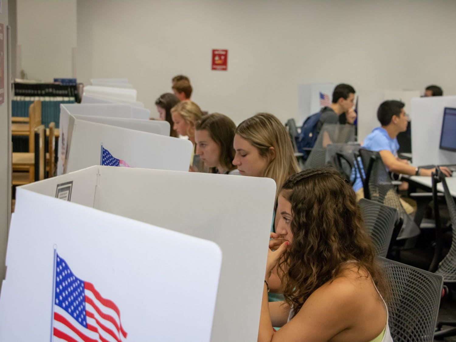 Students sit at voting stations at the Marston Science Library computer lab polling location and cast their votes for last Fall's Student Government elections on Sept. 25. Marston is one of several locations students can vote at on Wednesday.