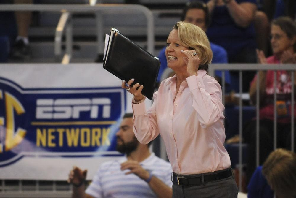 <p>Gators volleyball coach Mary Wise shouts from the sideline </p>