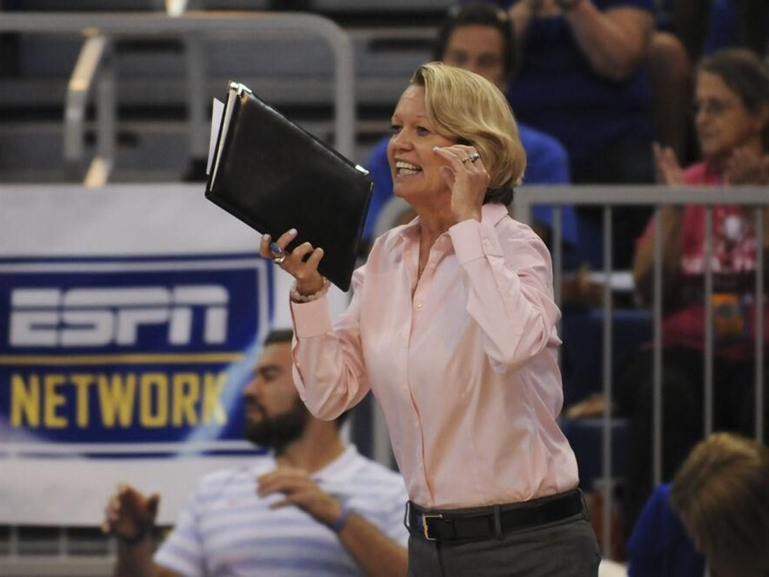Gators volleyball coach Mary Wise shouts from the sideline
