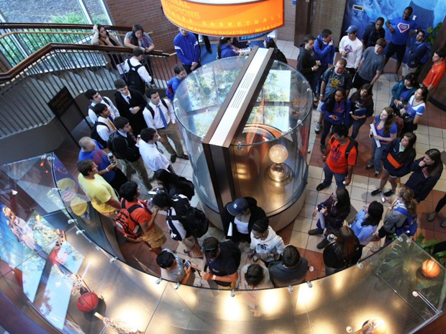Students gather in the lobby of the basketball complex during a tour of the practice facility at Rowdy Fest Monday night. Following the tour, students ate pizza and had a meet and greet with the men's basketball players and coaches.