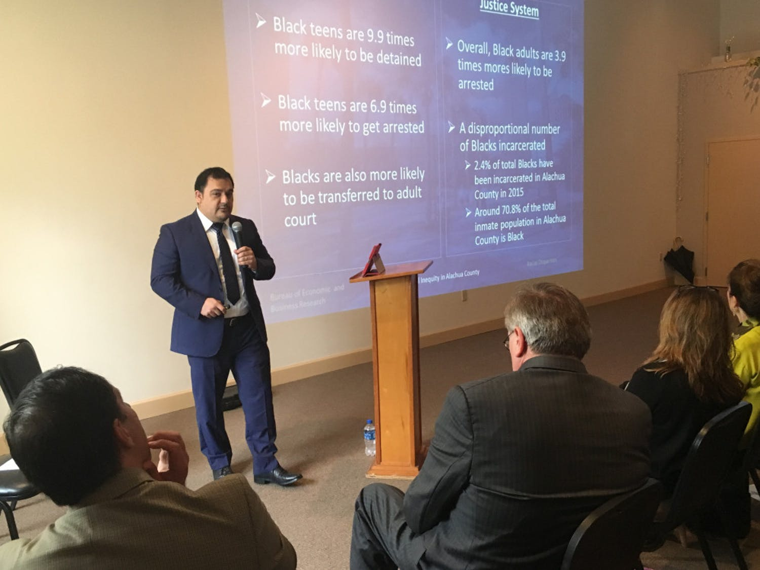UF assistant professor Hector Hugo Sandoval Gutierrez presents data on racial inequity within the county to an audience of more than 200 Friday afternoon at the Mt. Moriah Missionary Baptist Church, located at 718 SE 11th St.