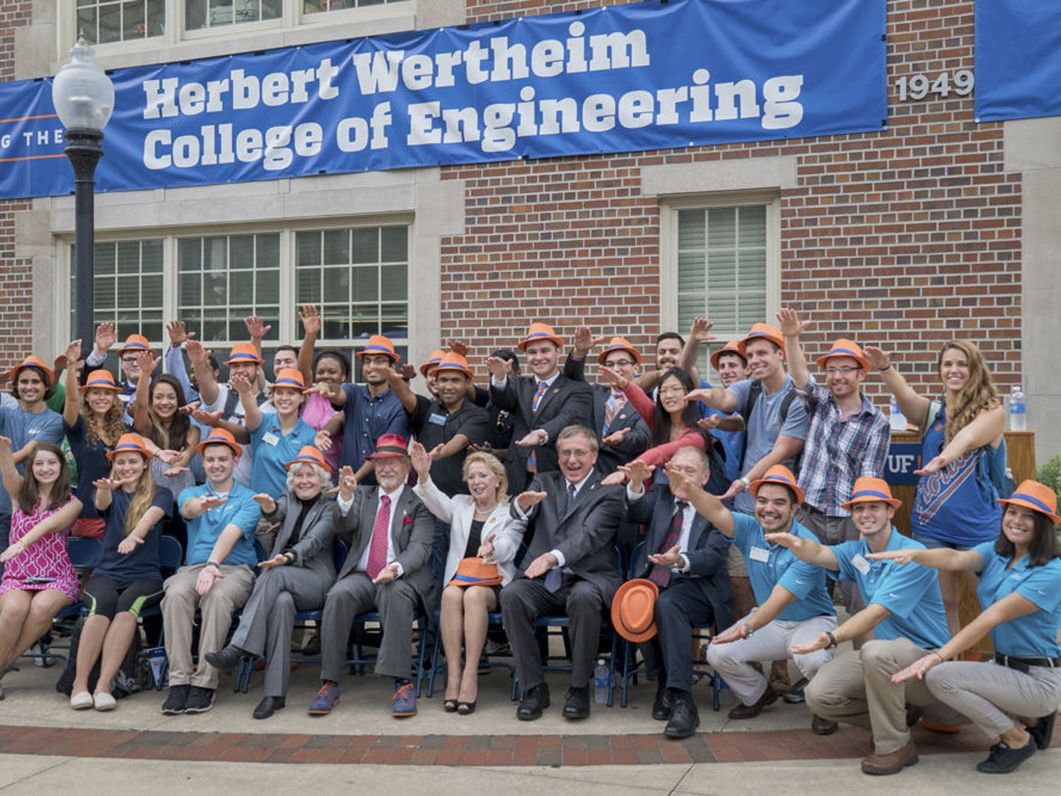 Herbert Wertheim (front row, fifth from left) does the Gator Chomp with UF students and faculty outside Weil Hall on Oct. 1, 2015. The College of Engineering is using Wertheim's $50 million donation to launch a $300 million research initiative.