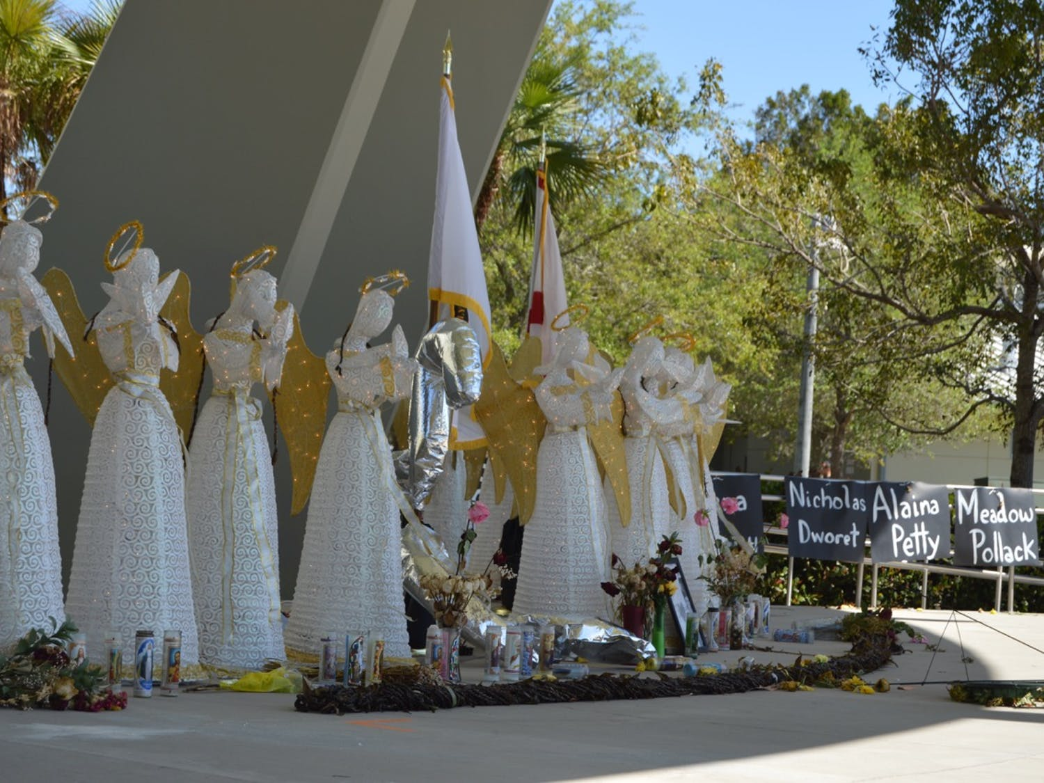Seventeen angel statues face outward at the memorial at Pine Trails Park in Parkland, Florida. The statues were put up for the vigil the day after the shooting.