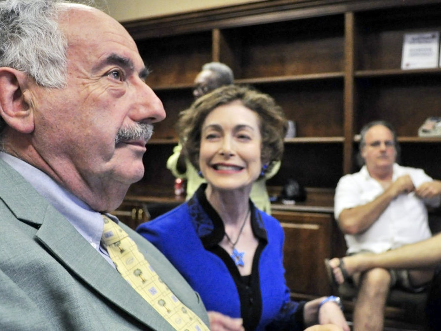 Harvey Budd and his wife Ilene Silverman react to the city commission election results at the Supervisor of Elections office on Tuesday. Budd, who received 33.31 percent of the vote, will run off for the at-large seat against Jay Curtis, who received 32.31 percent of the vote.