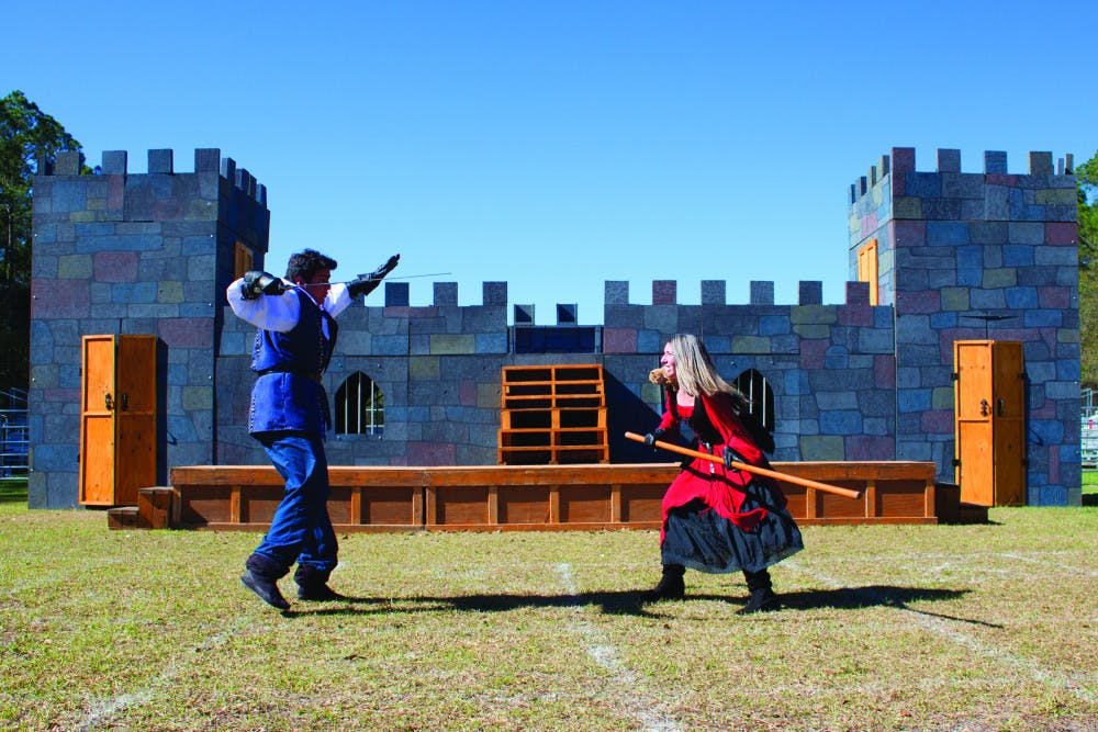 """<p><span id=""""docs-internal-guid-77edb030-de45-a8a2-9821-a5b5cfdbb702""""><span>Chris Rodd-Layedra, 24, and Sara Greenberg, 22, practice a fighting routine at the Alachua County Fairgrounds on Wednesday. Rodd-Layedra fights with a sword while Greenberg fights with a staff and a stuffed squirrel, which sits on her shoulders.</span></span></p>"""