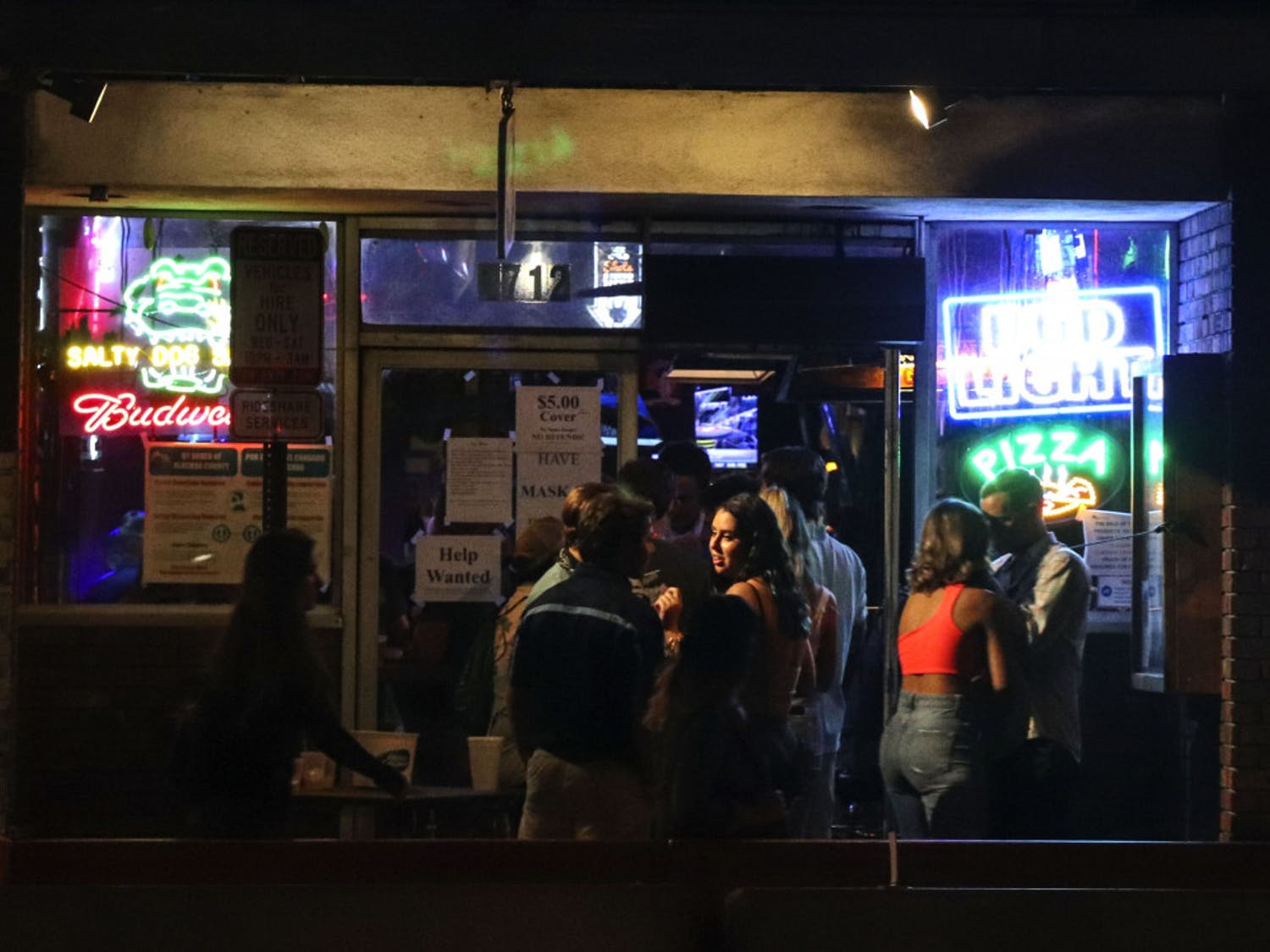 A group is seen waiting to enter Salty Dog Saloon, located off of West University Avenue at Midtown Friday night, Oct. 2, 2020. (Chasity Maynard/Alligator Contributor)