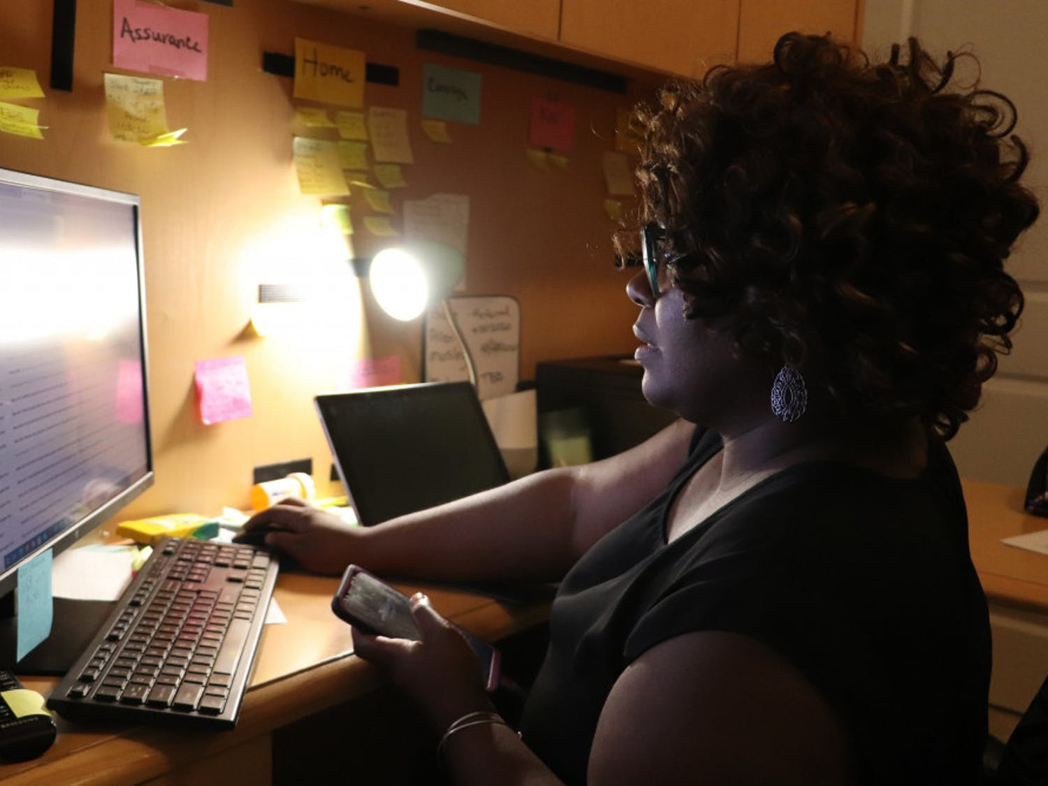 Chanae Jackson checks her email while talking on the phone in Ocala, Fla., on Thursday, Sept. 24, 2020. She said she spends about seven hours a day on the phone talking with clients, paying bills, following-up for her community work and client services, marketing her businesses and making personal phone calls.