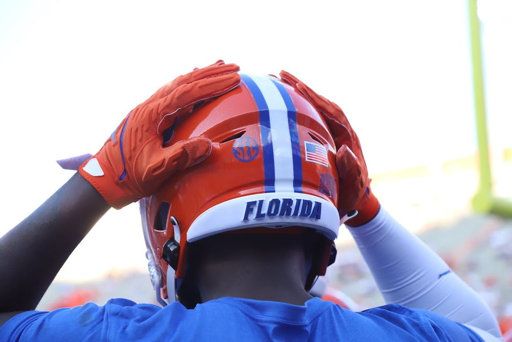 A Florida player touches his helmet during warmups before a game against Florida Atlantic on Sept. 4.