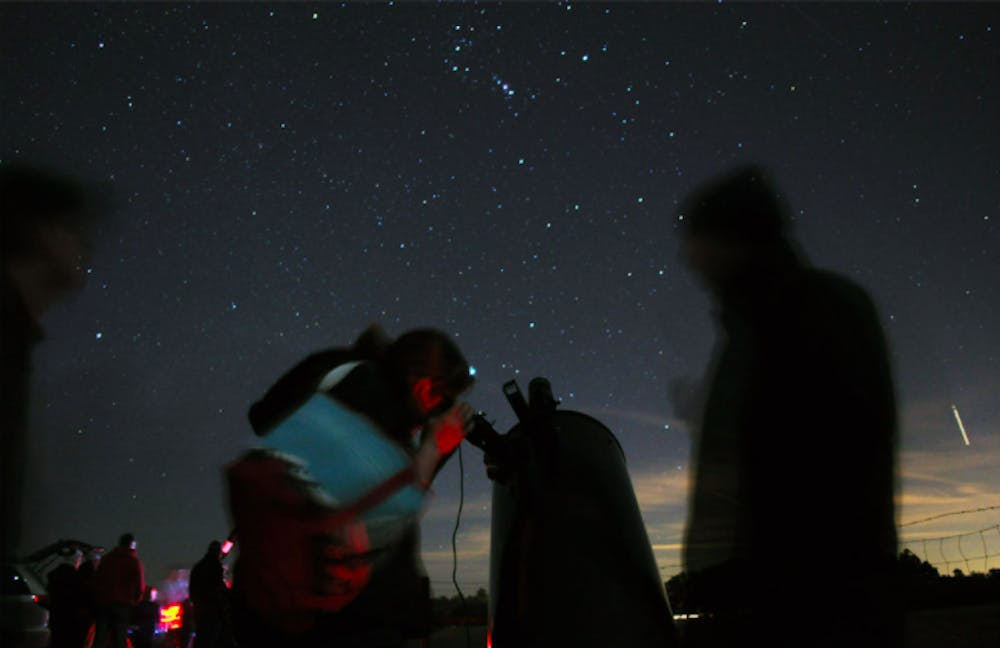 <p>Attendees at Paynes Prarie stargazing event check out the night sky a few years ago in January 2015.</p>