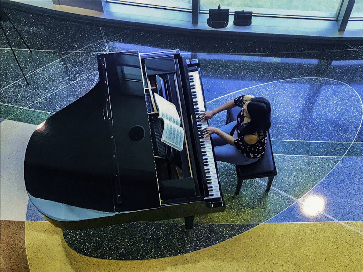 UF's International Piano Festival participant Ahui plays classical music at UF Health Shands Hospital.