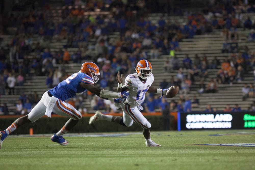 <div>Jordan Smith (left) attempts to tackle Kadarius Toney during Florida's Orange and Blue Debut on April 7. Smith received four recommended felony charges from the Gainesville Police Department on Wednesday after police said he payed his rent with someone else's credit card information. Smith had already received 18 recommended felony charges from University Police on Monday after police said he took over $5000 via stolen credit card information, according to UPD reports. </div>