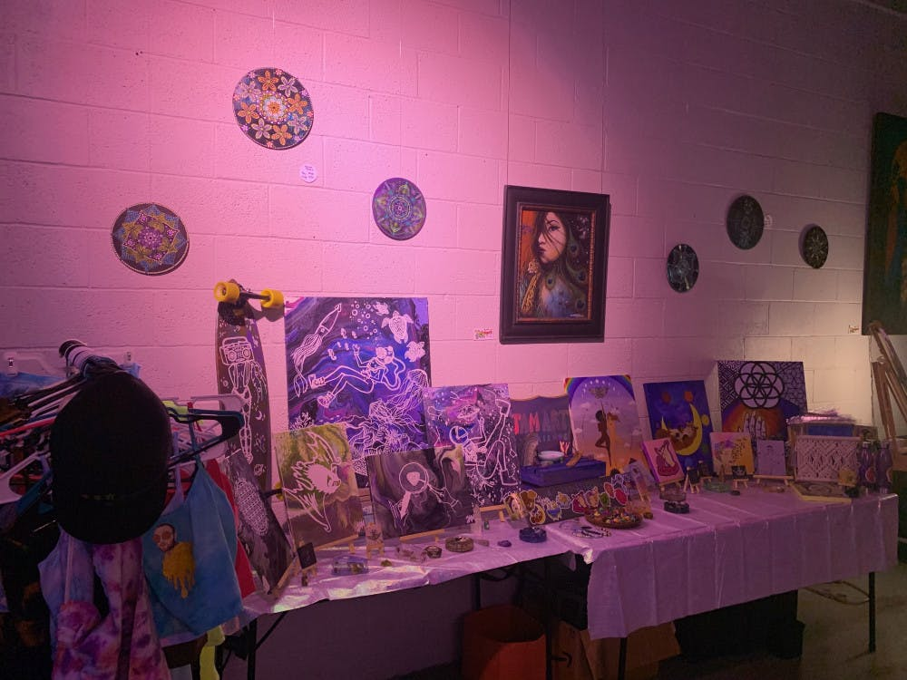 """<p dir=""""ltr""""><span>With rainbows and flashing colors of the projector on her art, Julia Monteiro showed her art at the Goddess Visions Artwalk Exhibition.</span></p>"""