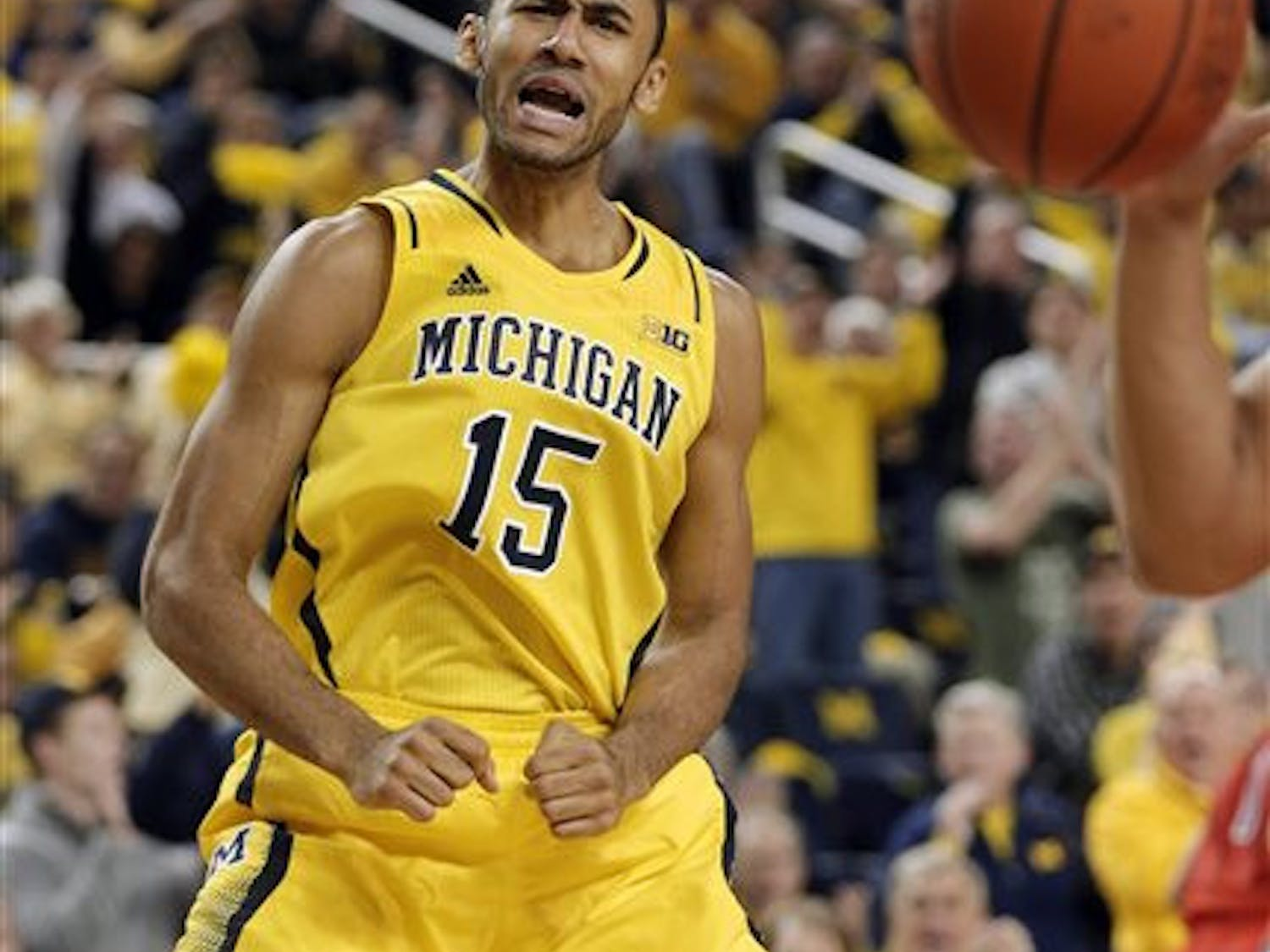 Michigan forward Jon Horford reacts after making a basket during a game against Arizona in Ann Arbor, Mich., on Dec. 14.