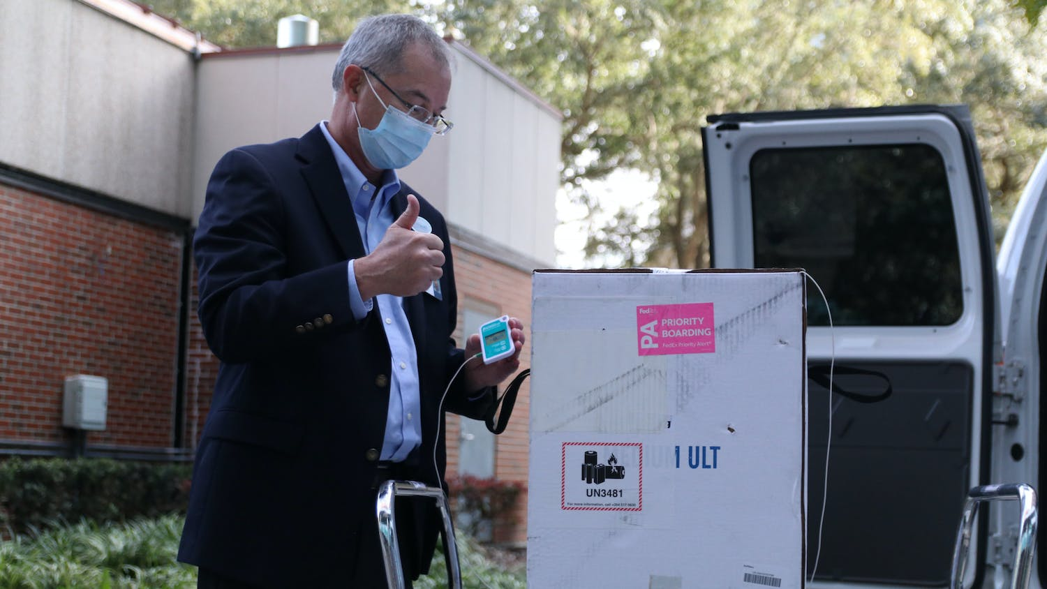 Thomas Johns, Director of Pharmacy Services at UF, gives a thumbs up after displaying the thermometer to the press. The Pfizer-BioNTech COVID-19 vaccine has to be stored at ultracold temperatures.