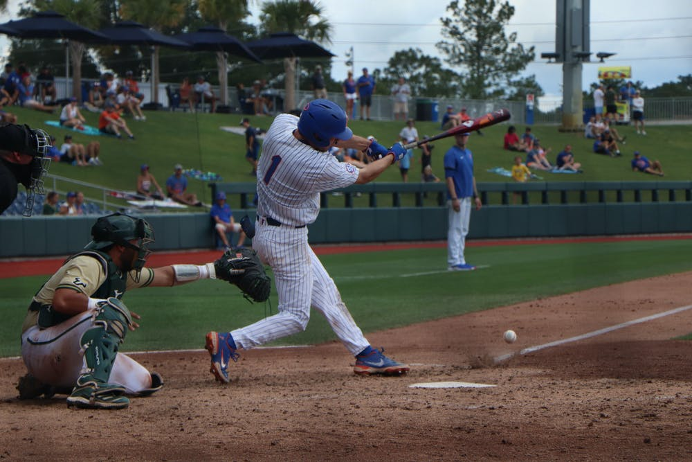 <p>Jacob Young swings against USF. The Gators lost to the Bulls 5-3 Friday.</p>