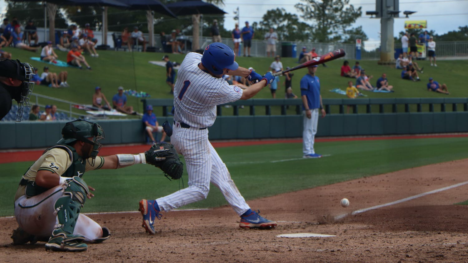 Jacob Young swings against USF. The Gators lost to the Bulls 5-3 Friday.