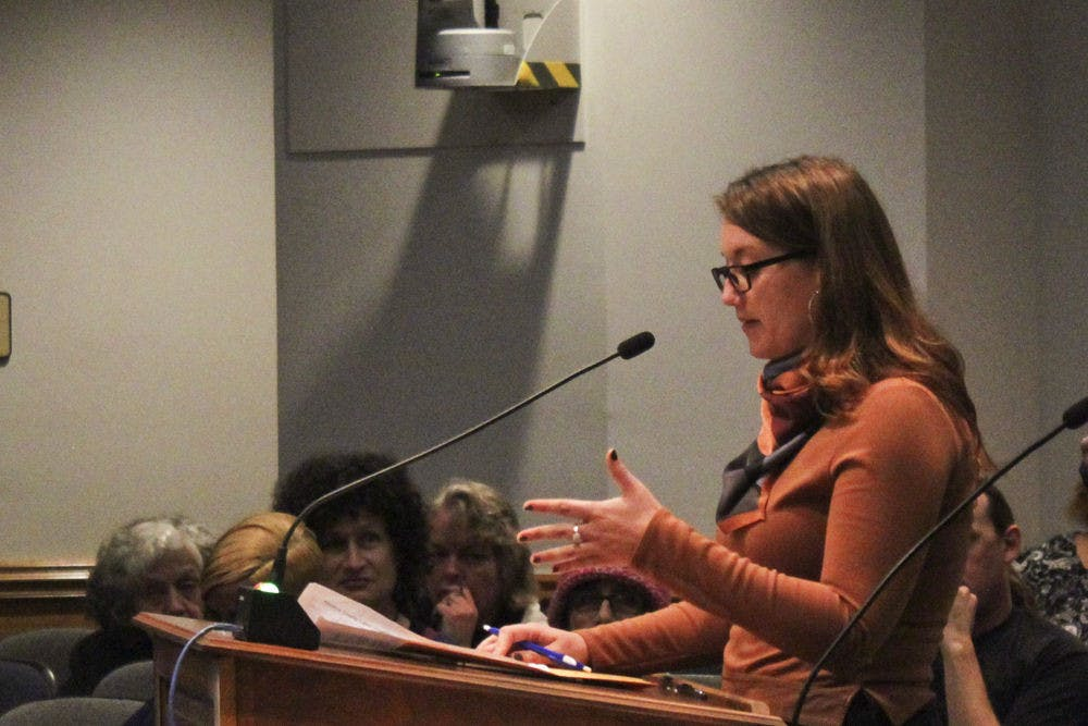 <p>Lauren Byers, a 24-year-old UF history senior, speaks during a city commission meeting on Thursday evening. Byers said she was disappointed with Mayor Ed Braddy's response to the Alachua County Labor Coalition's demand for a $15 minimum wage.</p>