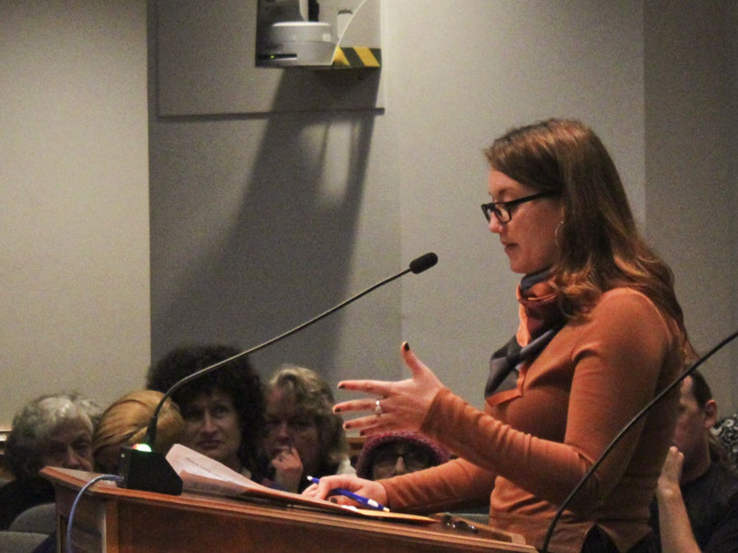 Lauren Byers, a 24-year-old UF history senior, speaks during a city commission meeting on Thursday evening. Byers said she was disappointed with Mayor Ed Braddy's response to the Alachua County Labor Coalition's demand for a $15 minimum wage.