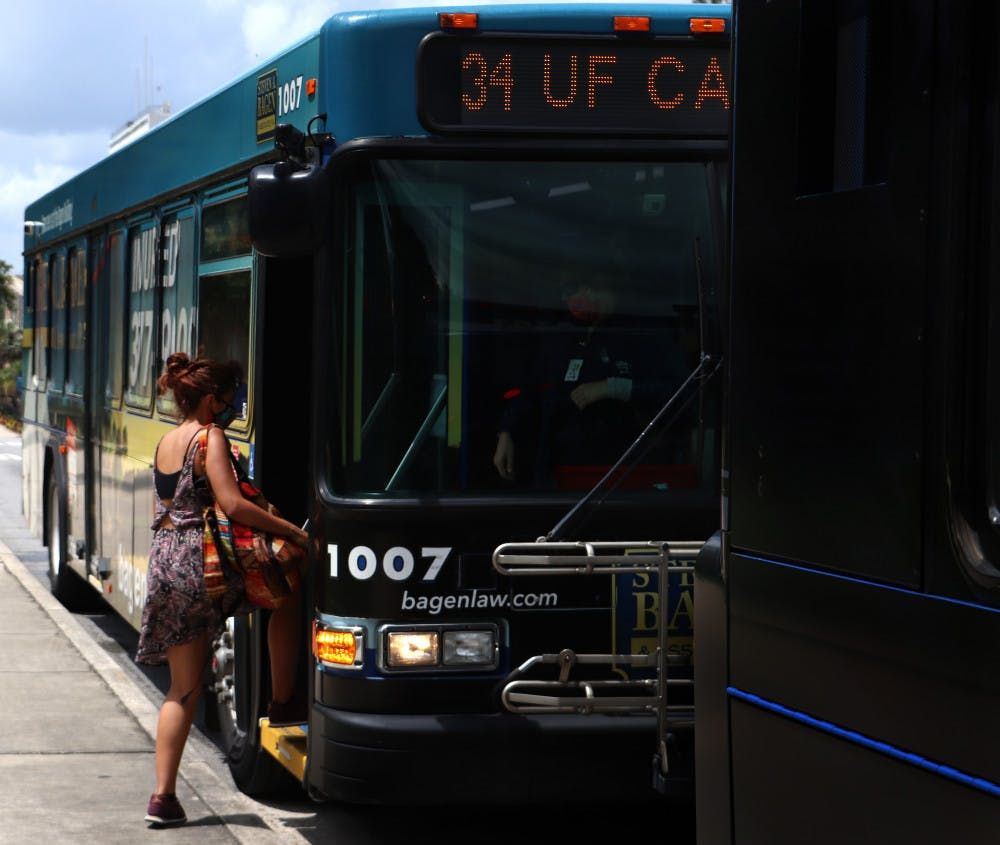 <p>UF first-year interdisciplinary ecology PH.D. student, Natalia Uribe, 29, boards RTS bus No. 34 on Wednesday, September 2, 2020. Uribe said she thinks the buses are safe and that not many people are using them.</p>