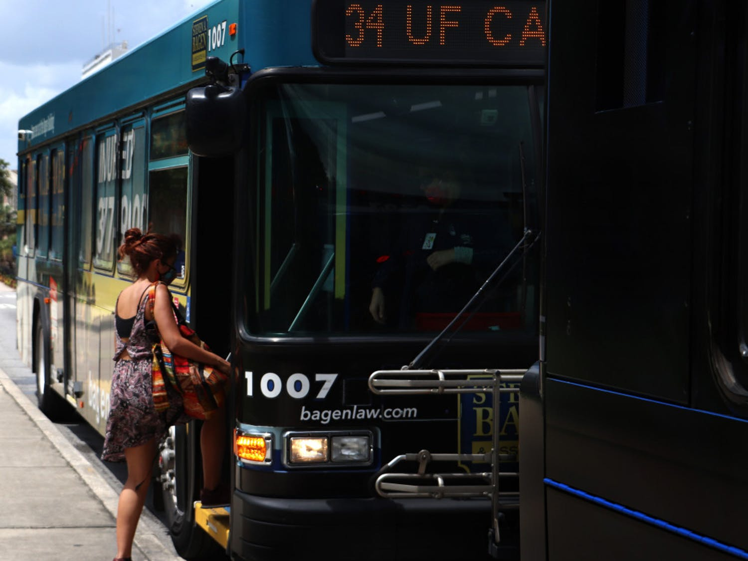 UF first-year interdisciplinary ecology PH.D. student, Natalia Uribe, 29, boards RTS bus No. 34 on Wednesday, September 2, 2020. Uribe said she thinks the buses are safe and that not many people are using them.