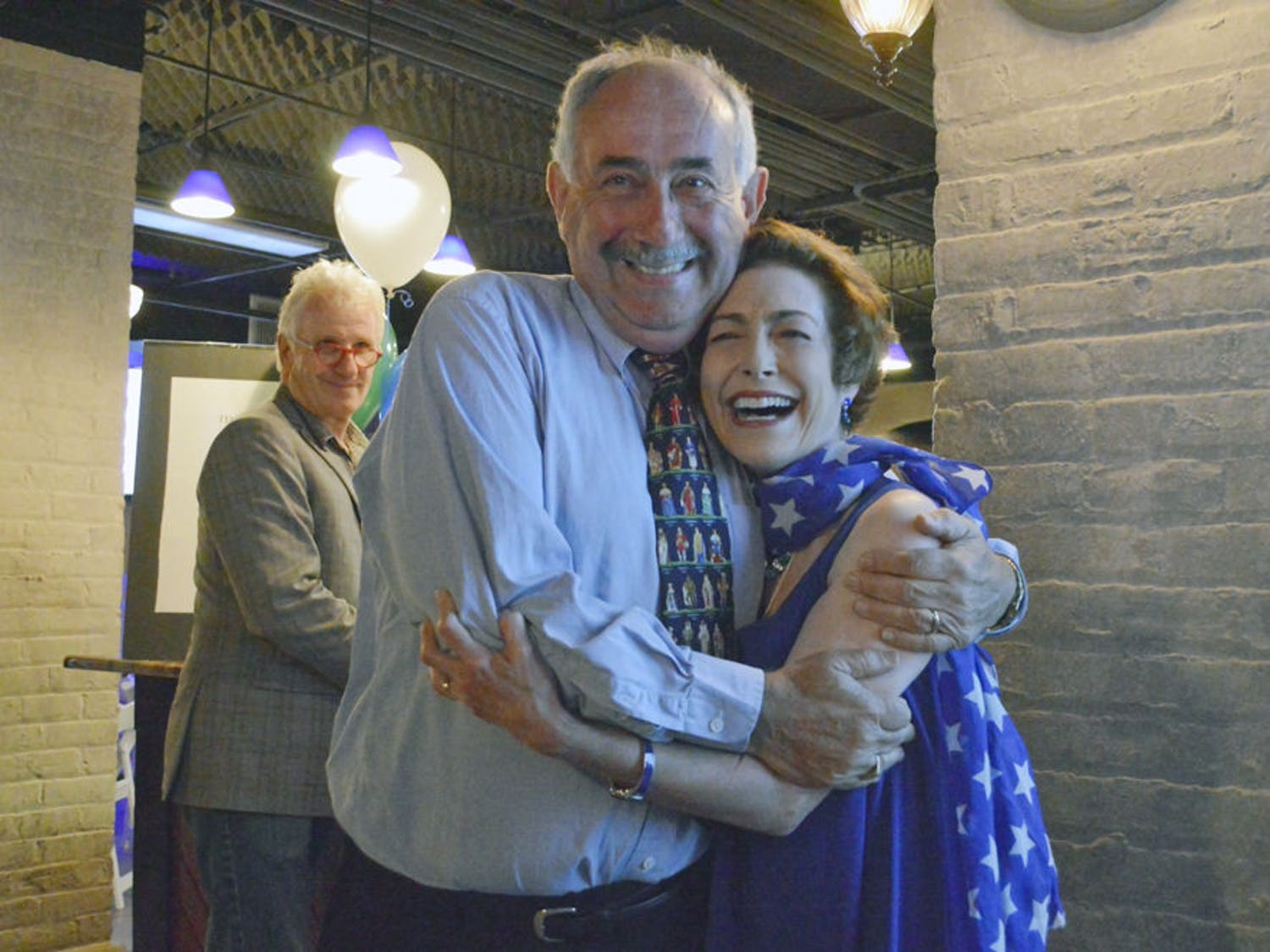 Harvey Budd and his wife, Ilene, celebrate Budd's victory over Jay Curtis in the race for the at-large commissioner seat Tuesday night in a banquet room in the Hippodrome Theater.