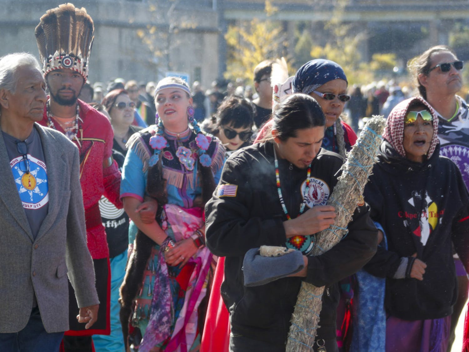A group of indigenous peoples lead a march of protestors against fracking and shale gas through Point State Park before a ceremony to bless the three rivers, Wednesday, Oct. 23, 2019, in Pittsburgh. The group is protesting before President Donald Trump is to speak at at the Shale Insight Conference Wednesday afternoon. (AP Photo/Keith Srakocic)