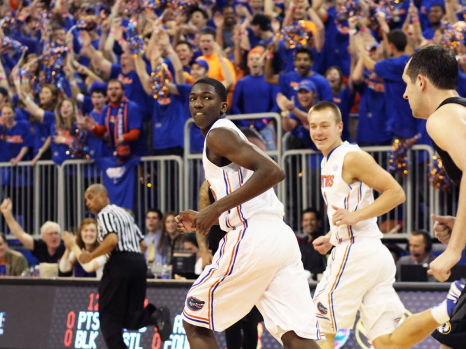 Freshman DeVon Walker runs down the court during Florida's 83-52 win against Missouri on Jan. 19 in the O'Connell Center. Walker announced Monday he will return to Florida after asking for his release to transfer on May 6.