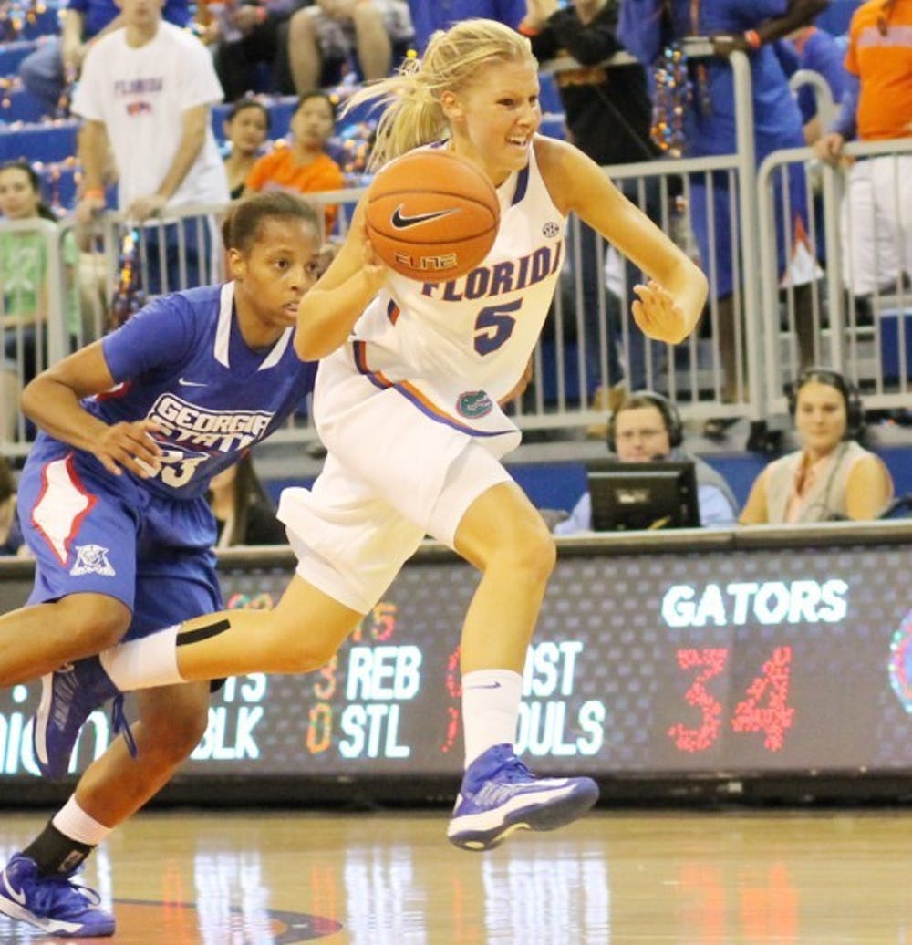 <p>Guard Chandler Cooper (5) dribbles past Georgia State guard Ashley Watson during the Gators' 84-65 win on Nov. 11 in the O'Connell Center. After seeing time in only three games for the Gators in 2012-13 because of a left foot injury, Cooper has decided to transfer to Lipscomb University.&nbsp;</p>
